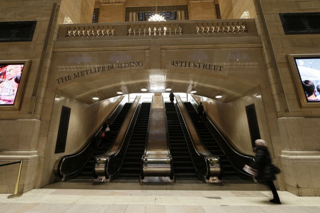 Commuters walk in a near-empty Grand Central Station Terminal on Monday morning in New York City. Mayor Bill de Blasio told residents to prepare for the possibility of a shelter-in-place order in the city. Photo by John Angelillo/UPI