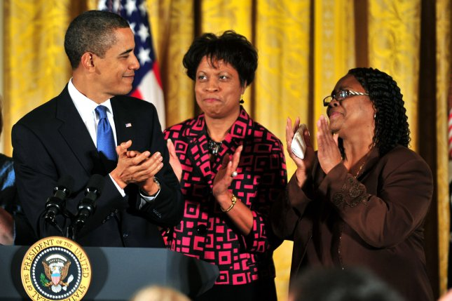 President Barack Obama (L) claps with Louvon Harris (C) and Betty Byrd Boatner, the sisters of James Byrd, Jr., who was a victim of a hate crime, as he delivers remarks on the passing of the Matthew Shepard Hate Crimes Prevention Act, at the White House in Washington on October 28, 2009. On June 7, 1998, three white supremacists killed Byrd by dragging him for 3 miles behind a pickup truck in Jasper, Texas. File Photo by Kevin Dietsch/UPI