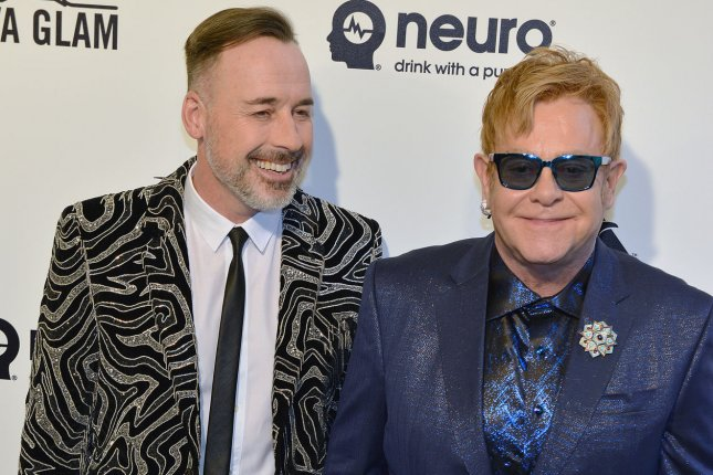 Sir Elton John (R) and David Furnish arrive at the Elton John Aids Foundation's 24th Annual Academy Awards viewing party in West Hollywood, Calif. on February 28, 2016. Photo by Christine Chew/UPI