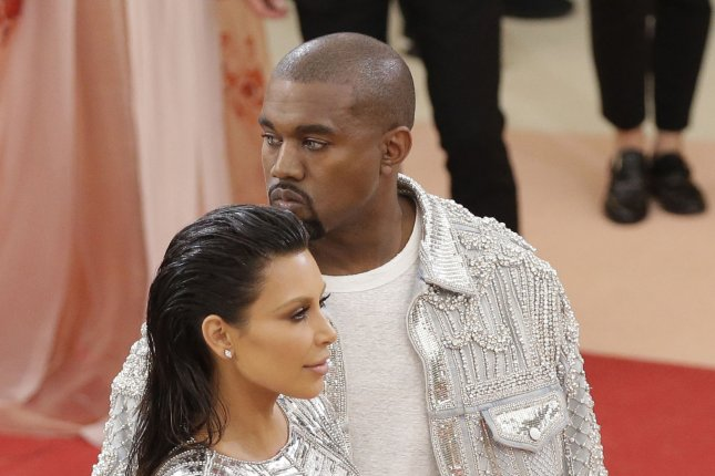 Kanye West (R) and Kim Kardashian at the Costume Institute Benefit at the Metropolitan Museum of Art on May 2. The rapper will kick off a new tour in August. File Photo by John Angelillo/UPI