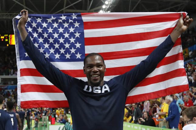 Kevin Durant of the United States celebrates after the game against Serbia in the Men's Basketball gold medal game between Serbia and the United States at Carioca Arena 1 at the 2016 Rio Summer Olympics in Rio de Janeiro, Brazil, on August 21, 2016. The United States defeated Serbia 96-66 to win its third consecutive gold medal. Photo by Matthew Healey/UPI