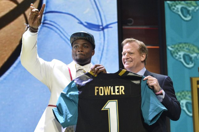 Florida's Dante Fowler Jr. (L) stands with NFL Commissioner Roger Goodell after he was announced as the third overall pick in the draft selected by the Jacksonville Jaguars during the first round of the NFL Draft on April 30, 2015 in Chicago. File photo by Brian Kersey/UPI