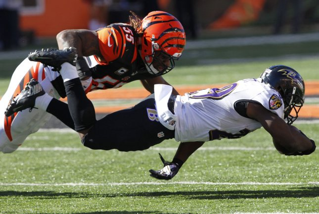 Cincinnati Bengals linebacker Vontaze Burfict makes a tackle during a game against the Baltimore Ravens. Photo by John Sommers II/UPI