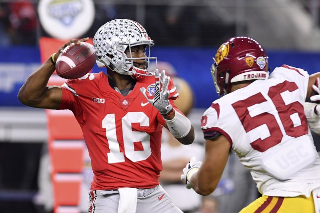 Former Ohio State quarterback J.T. Barrett looks to pass during the Cotton Bowl vs. USC in December. Photo by Shane Roper/UPI