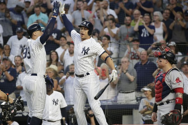 New York Yankees outfielder Aaron Judge celebrates with Giancarlo Stanton after he hit a solo home run against the Boston Red Sox on July 1 at Yankee Stadium in New York City. Photo by John Angelillo/UPI