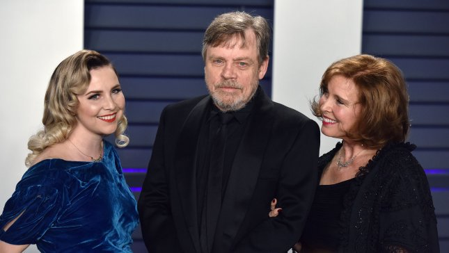 Actor Mark Hamill, seen here with his daughter Chelsea and wife Marilu, is lending his voice to the demonic doll Chucky in the new horror movie, Child's Play. File Photo by Christine Chew/UPI