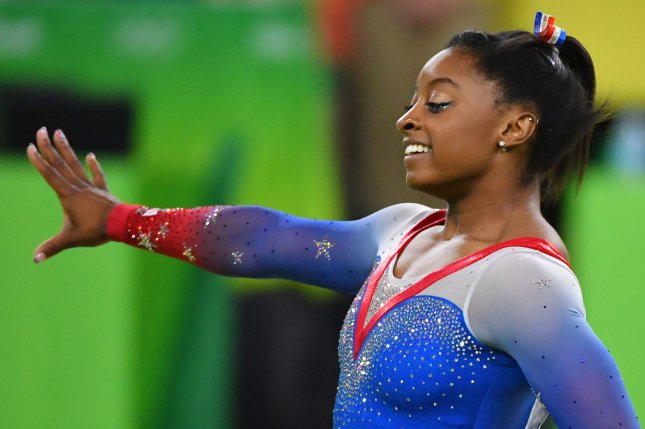 Four-time Olympic gold medalist Simone Biles will attempt to qualify for the Team USA gymnastics team for Tokyo 2020 this weekend at the Olympic trials in St. Louis. File Photo by Kevin Dietsch/UPI