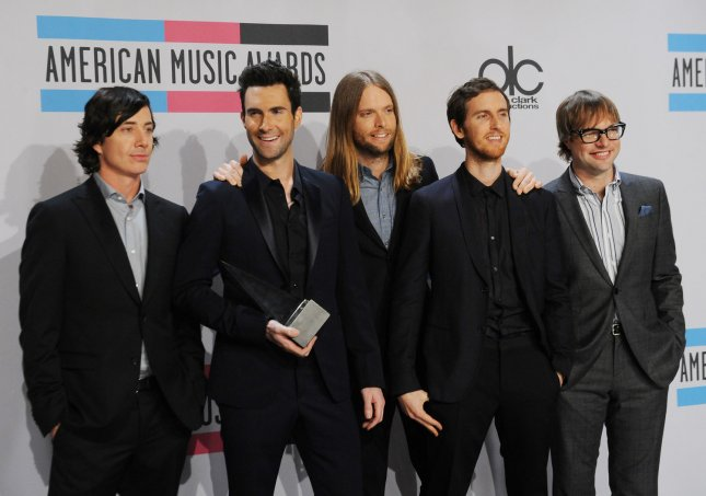 Maroon 5 appears backstage with the favorite band, duo or group award they garnered at the 39th American Music Awards at Nokia Theatre in Los Angeles on November 20, 2011. UPI/Jim Ruymen