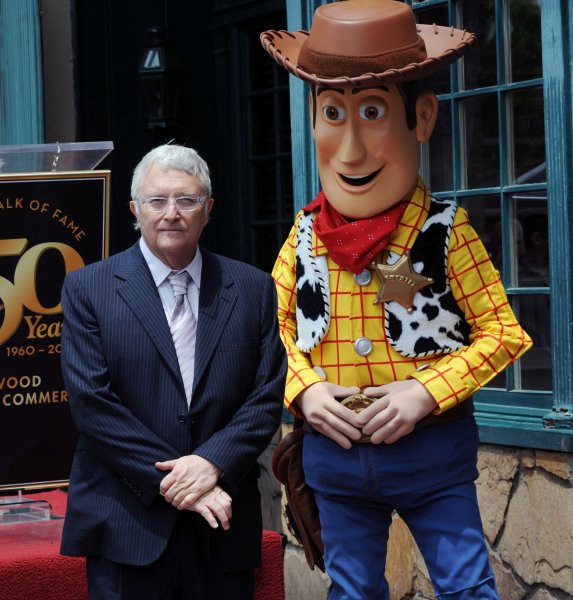 Singer, composer and songwriter Randy Newman is joined by Woody of Disney Pixar's Toy Story 3 during an unveiling ceremony honoring him with the 2,411th star on the Hollywood Walk of Fame in front of the historic Musso & Frank Grill in Los Angeles on June 2, 2010. UPI/Jim Ruymen