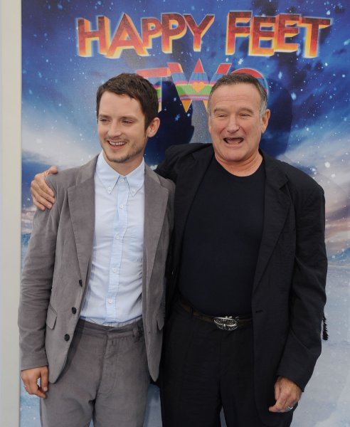 People can successfully change their moods and try to be happier. Elijah Wood (L) and Robin Williams, cast members in the animated motion picture comedy Happy Feet Two, attend the premiere of the film at Grauman's Chinese Theatre in the Hollywood section of Los Angeles on November 13, 2011. UPI/Jim Ruymen