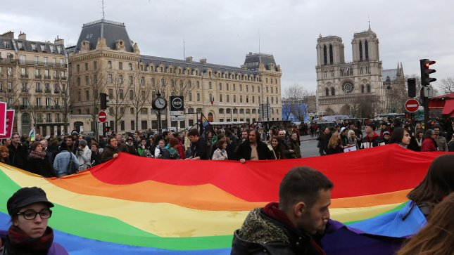 Supporters march near Notre Dame Cathedral during a pro-gay marriage demonstration in Paris on December 16, 2012. UPI/David Silpa