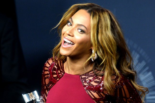 Beyonce poses with her awards backstage at the 2014 MTV Video Music Awards at the Forum in Inglewood, California on August 24, 2014. UPI/Jim Ruymen