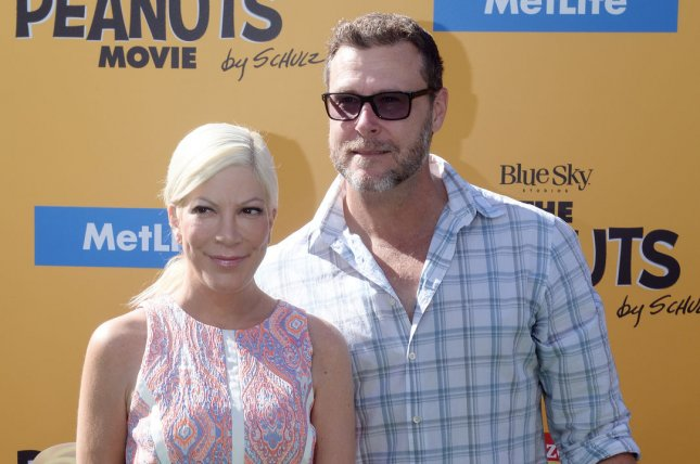 Tori Spelling (L) and husband Dean McDermott at the Los Angeles premiere of The Peanuts Movie on November 1, 2015. The actress is being sued over reported credit card debt. File Photo by Jim Ruymen/UPI