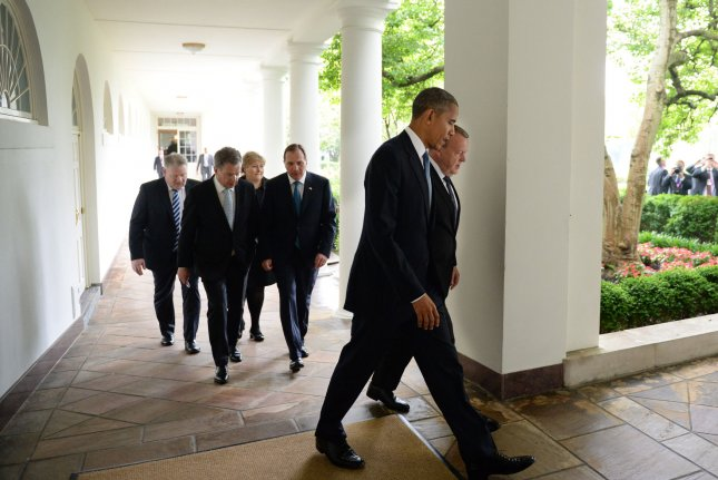 President Barack Obama talks with Danish Prime Minister Lars Lokke Rasmussen as they and other Nordic leaders walk along the White House Colonnade to the Oval Office during a State Visit in Washington, D.C., on Friday. Other Nordic leaders are (second row, L-R) Finnish President Sauli Niinisto and Swedish Prime Minister Stefan Lofven, (third row) Icelandic Prime Minister Sigurdur Ingi Johannsson and Norwegian Prime Minister Erna Solberg. Photo by Pat Benic/UPI