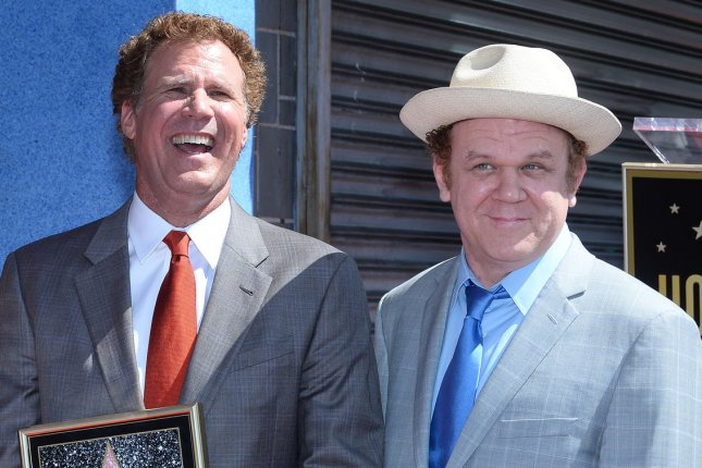Will Ferrell (L) poses with John C. Reilly during an unveiling ceremony honoring Ferrell with the 2,547th star on the Hollywood Walk of Fame in Los Angeles on March 24, 2015. Ferrell and Reilly have signed on to star in comedy Holmes & Watson. File Photo by Jim Ruymen/UPI