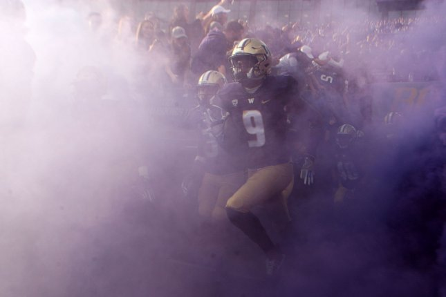 Washington Huskies running back Myles Gaskin (9) runs through a cloud of purple smoke while coming onto the field in their game against the Oregon State Beavers at Husky Stadium October 22, 2016 in Seattle. Gaskins rushed for 128 yards on 18 carries and scored one touchdown in the Huskies 41-17 win over the Beavers . Photo by Jim Bryant/UPI