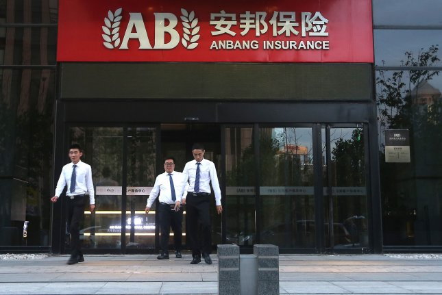 Chinese office workers leave Anbang Insurance's China headquarters in Beijing on Wednesday. The company chairman Wu Xiaohui was reportedly detained and the company said Wu has temporarily left the company. Photo by Stephen Shaver/UPI