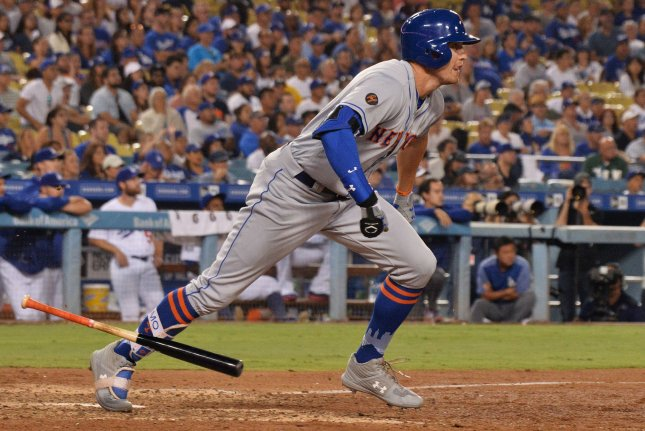 New York Mets' Brandon Nimmo drops his bat after crushing a three-run homer off Los Angeles Dodgers' reliever Kenta Maeda in the eighth inning on Monday at Dodger Stadium in Los Angeles. Photo by Jim Ruymen/UPI