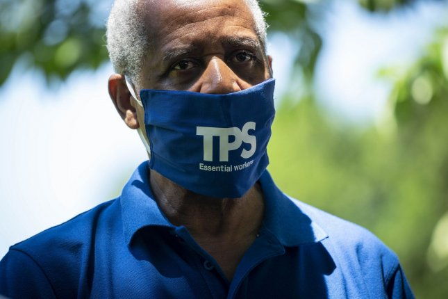 A man participates in a National Temporary Protected Status Alliance press conference outside of the U.S. Capitol on June 24. Photo by Sarah Silbiger/UPI