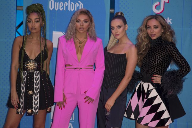Jesy Nelson (second from left), pictured with Leigh-Anne Pinnock, Perrie Edwards and Jade Thirwall (from left to right), will take extended time off from Little Mix to address medical issues. File Photo by Sven Hoogerhuis/UPI