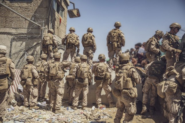 U.S. Marines assist with security at an evacuation control checkpoint at Hamid Karzai International Airport in Kabul, Afghanistan, on August 26. Photo by Staff Sgt. Victor Mancilla/USMC