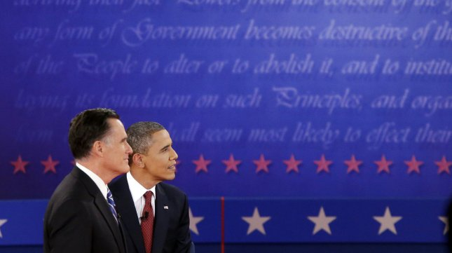Republican nominee Mitt Romney and President Barack Obama listen to a question during the second presidential debate at Hofstra University in Hempstead, New York on October 16, 2012. UPI/John Angelillo