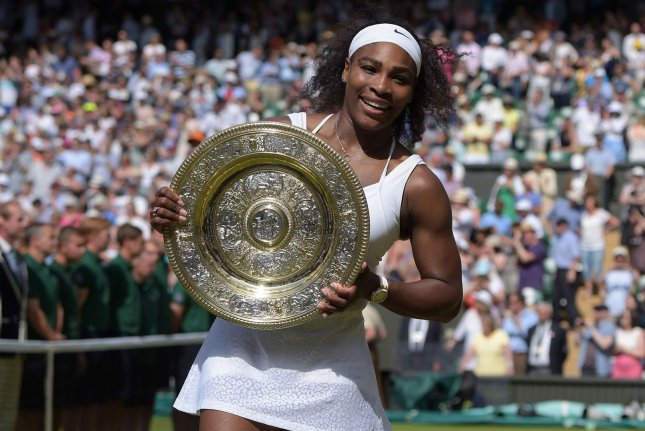 American Serena Williams holds the trophy after winning the Women's Singles Final against Spain's Garbine Muguruza on day twelve of the 2015 Wimbledon championships, London on July 11, 2015.Williams won the match 6-4, 6-4. Photo by Hugo Philpott/UPI.