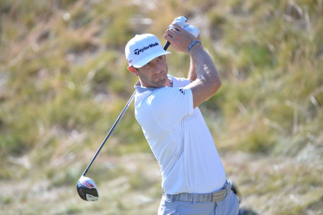 Dustin Johnson tees off on the 13th hole of the fourth round of the 115th U.S. Open Championship at Chambers Bay on June 21, 2015 in University Place, Washington. Photo by Kevin Dietsch/UPI