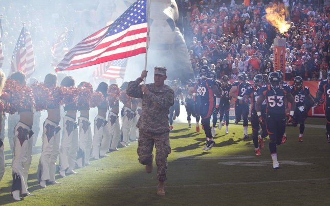 The Denver Broncos are introduced during pre-game activities that honored the military at Sports Authority Field at Mile High on November 18, 2012 in Denver. UPI/Gary C. Caskey