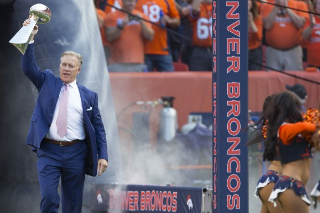 Former Denver Broncos QB John Elway kicked off the 2016 NFL season by bringing one the Broncos three Super Bowl trophies onto the field before their season opener at Sports Authority Field at Mile High in Denver on September 8, 2016. The Broncos defeated the Panthers 21-20. Photo by Gary C. Caskey/UPI