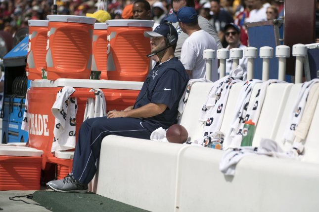 Dallas Cowboys QB Tony Romo sits on the bench during the Cowboy's game against the Washington Redskins at FedEx Field in Landover, Maryland on September 18, 2016. Romo is sidelined with a back injury. Photo by Kevin Dietsch/UPI