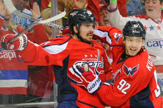 20553288245 Washington Capitals center Marcus Johansson (90) is congratulated by center  Evgeny Kuznetsov (92) after scoring against the Pittsburgh Penguins in the  third ...
