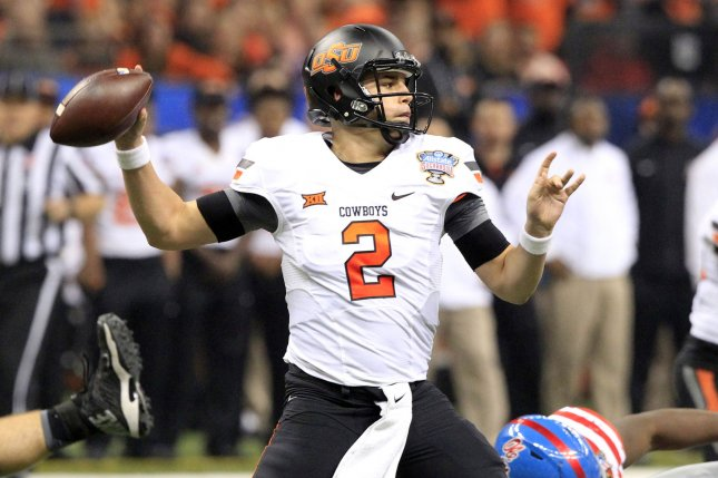 Oklahoma State Cowboys quarterback Mason Rudolph (2) looks to throw the ball against the Mississippi Rebels during the first quarter of the 2016 Allstate Sugar Bowl at the Mercedes-Benz Superdome in New Orleans. File photo by A.J. Sisco/UPI