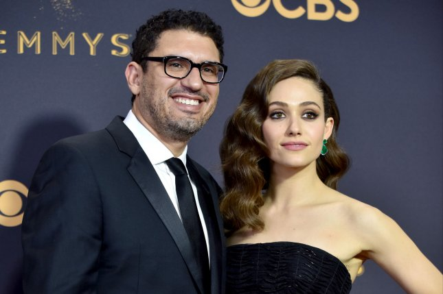 Emmy Rossum (R), pictured with Sam Esmail, discussed her impending exit from Shameless in a new interview. File Photo by Christine Chew/UPI