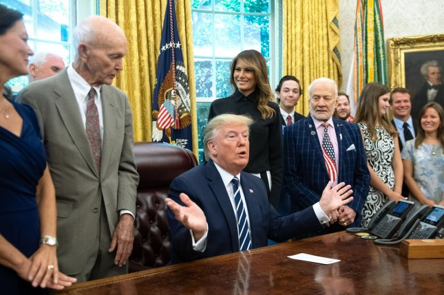 Michael Collins (L) said NASA should go to Mars directly instead of President Donald Trump's plans to go to the moon first. Buzz Aldrin (R) said Collins was impatient. Photo by Kevin Dietsch/UPI