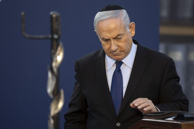 Israeli Prime Minister Benjamin Netanyahu, who was indicted on multiple charges Thursday, is seen at an event in Jerusalem, Israel, on November 10. Photo by Heidi Levine/UPI/Pool