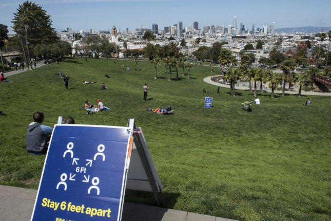 Delores Park, usually packed with sunbathers on a beautiful day, has only a few people, in San Francisco on Sunday. Photo by Terry Schmitt/UPI