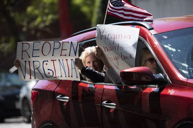 Protesters demonstrate from vehicles, calling on Virginia Gov. Ralph Northam to reopen Virginia on Wednesday.  Photo by Kevin Dietsch/UPI