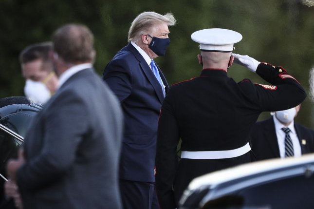 U.S. President Donald Trump exits Marine One after arriving at Walter Reed National Military Medical Center in Bethesda, Md., on Friday. Photo by Oliver Contreras/UPI