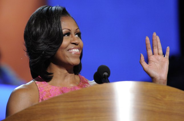 First Lady Michelle Obama waves after her speech during the 2012 Democratic National Convention at the Time Warner Cable Arena in Charlotte, North Carolina on September 4, 2012. UPI/Mike Theiler