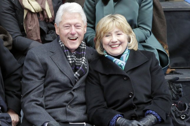 Hillary and Bill Clinton wait in their seats before the Swearing-In and inauguration ceremonies for Mayor-elect Bill de Blasio at City Hall in New York City. (UPI/John Angelillo)