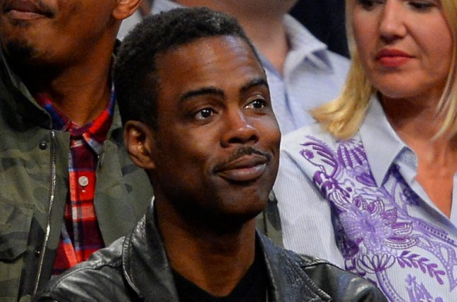 Actor, comedian Chris Rock looks on as the Brooklyn Nets take on the Miami Heat at Barclays Center in New York City on November 1, 2013. UPI/Rich Kane