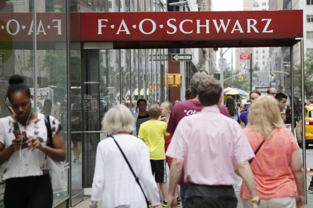 People walk by FAO Schwarz on its last day of operation at 767 Fifth Ave., in New York City on July 15, 2015. Tuesday, the founder of sportswear giant Under Armour said during an earnings call that his company planned to move into the famous Manhattan retail location as soon as 2018. File Photo by John Angelillo/UPI