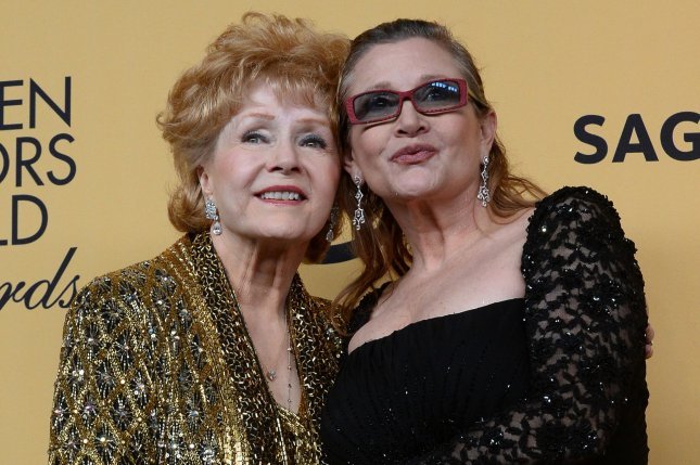 Debbie Reynolds, 84, died in Los Angeles on December 28, 2016, one day after her daughter Carrie Fisher (R) died. Fisher, 60, suffered a heart issue on a flight from London to Los Angeles Dec. 23. They are shown in January 2015 when Debbie Reynolds received the Screen Actors Guild Lifetime Award. File Photo by Jim Ruymen/UPI