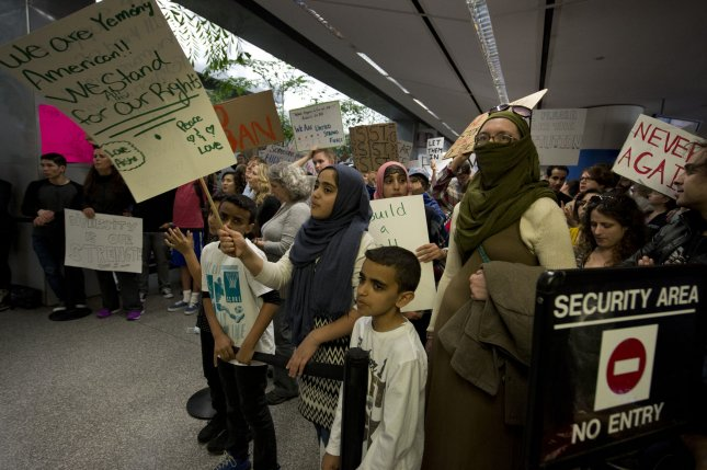 Demonstrators jam the international arrivals area at San Francisco International Airport in San Francisco on January 29, 2017. Protesters called for a lifting of the ban on arriving Muslims and lawyers offered legal service to arriving foreign nationals. A federal appeals court in San Francisco announced Monday it will hear arguments for and against President Donald Trump's controversial executive order to temporarily bar entry into the United States for refugees and immigrants. File Photo by Terry Schmitt/UPI