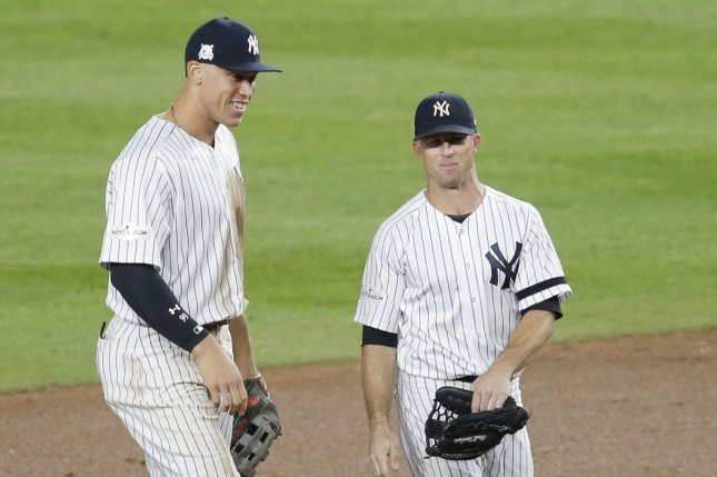 New York Yankees Brett Gardner and Aaron Judge smile after defeating the Minnesota Twins 8-4 in the 2017 MLB Playoffs American League Wild Card Game at Yankee Stadium in New York City on October 3, 2017. The Yankees advance to play the Cleveland Indians in the ALDS. Photo by John Angelillo/UPI