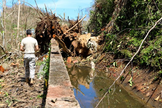 National Guardsmen help clean up Puerto Rico on October 2 after Hurricane Maria. Friday, President Donald Trump ordered an extension of disaster aid. File Photo by Sgt. Alexis Velez/PRNG/UPI