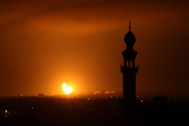 The Israeli Defense Forces said it struck a military compound in Gaza in response to two rockets that were fired from the region on Saturday night. Photo by Ismael Mohamad/UPI