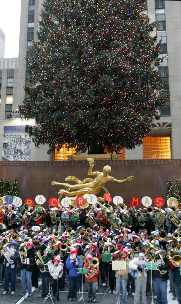 Four hundred and sixty-three tuba players assemble below the giant Christmas tree for the Tubachristmas concert at Rockefeller Center on December 9, 2007 in New York. The tuba concerts, which began in 1974, take place around the country on various dates. (UPI Photo/Monika Graff).