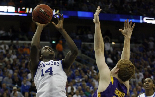 Kentucky forward Michael Kidd-Gilchrist (14) shoots over the head of LSU defender Eddie Ludwig (13) first half action in the second round of the NCAA SEC Men's Basketball Tournament at New Orleans Arena in New Orleans March 9, 2012. UPI/A.J. Sisco